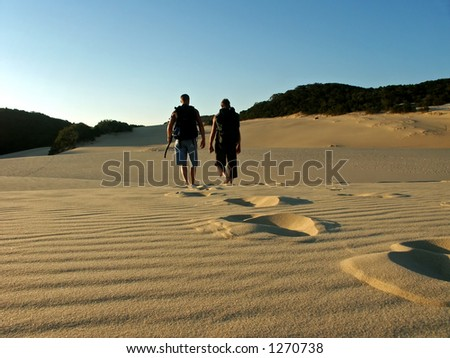 father and son hiking fraser island dunes near lake wobby in australia - stock photo