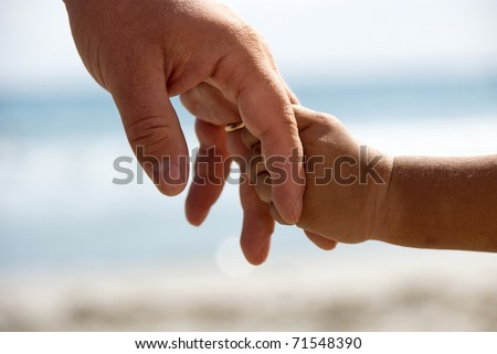 Father and son holding hands - stock photo