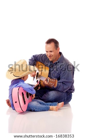 Father and son holding their guitar