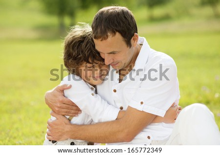 Father And Teenage Son Hug