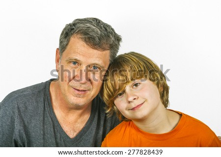 father and son hugging in studio isolated on white - stock photo