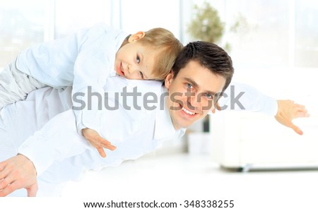 father and son imitate plane - stock photo
