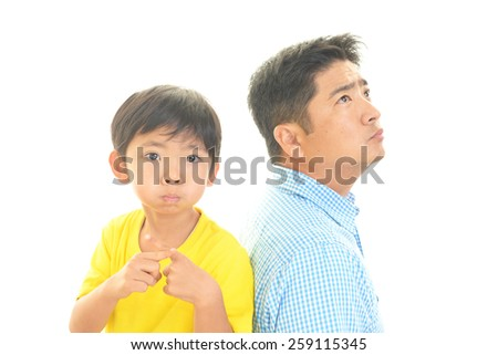 Father and son in a bad mood - stock photo