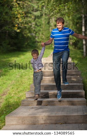 Father and son in a jump