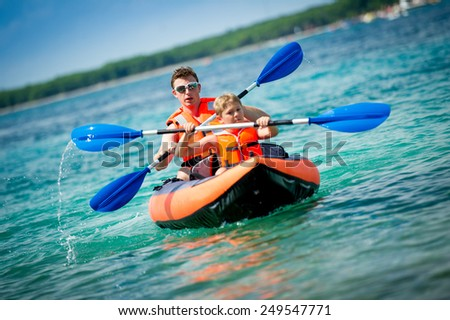 father and son in a kayak