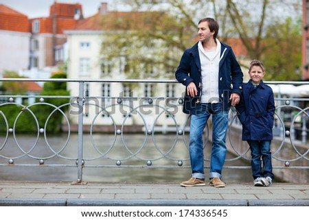 Father and son in European city on spring day - stock photo