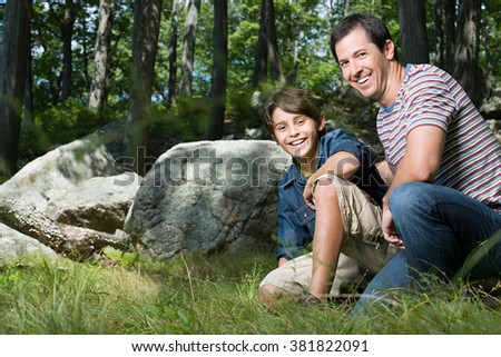 Father and son in forest - stock photo