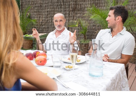 Father and son in garden having some food - stock photo