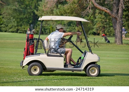 Father and Son in Golf Cart - stock photo