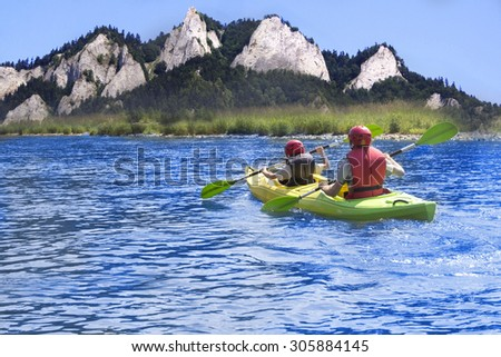 father and son in kayak - stock photo