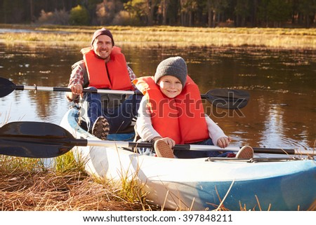 Father and son in kayak on lakeside, California - stock photo