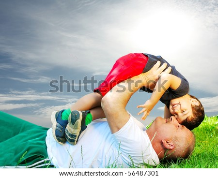 Father and son in nature - stock photo