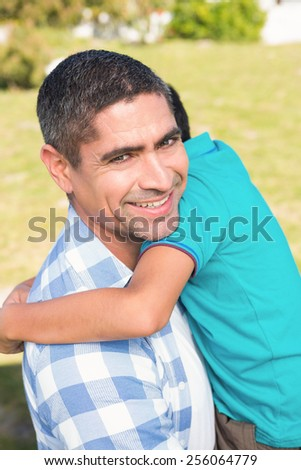 Father and son in the countryside on a sunny day - stock photo