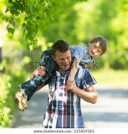 Father and son in the park. - stock photo