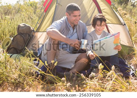Father and son in their tent on a sunny day - stock photo