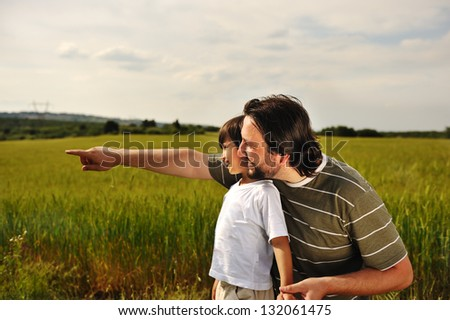 Father and son in wheat at summer - stock photo