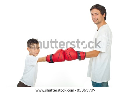 Father and son in white t-shirts having competition with red boxing gloves isolated on white background - stock photo
