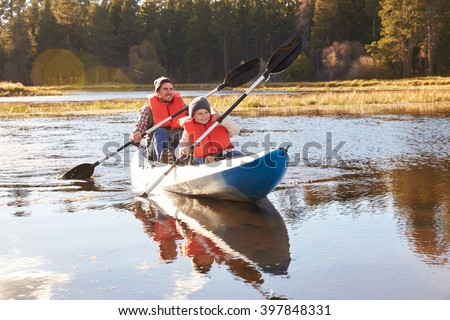 Father and son kayaking on lake, California, USA - stock photo