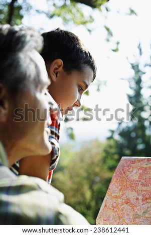 Father and Son Looking at a Map - stock photo