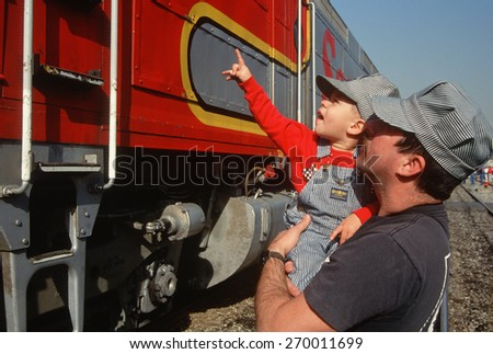 Father and son looking at historic trains, Santa Fe, New Mexico                       - stock photo