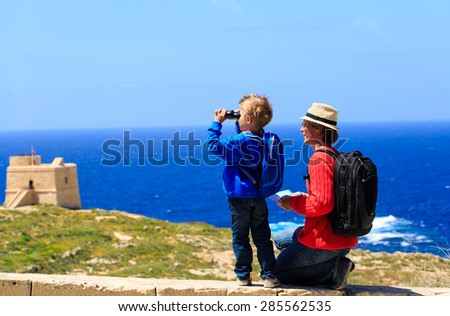 father and son looking at scenic view, family travel - stock photo