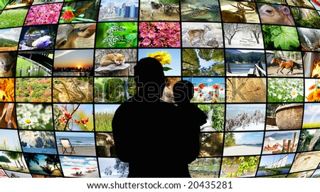 father and son looking at tv screens showing beauty in nature - stock photo