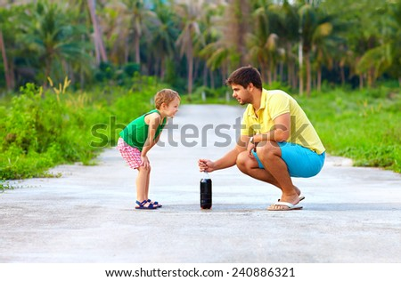 father and son making chemical experiment, funny education - stock photo