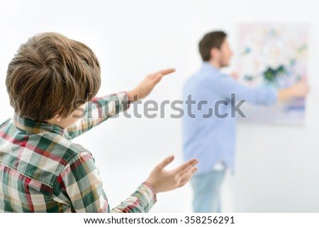 Father and son making renovation at home  - stock photo