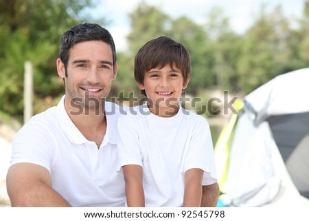 Father and son on a camping trip - stock photo
