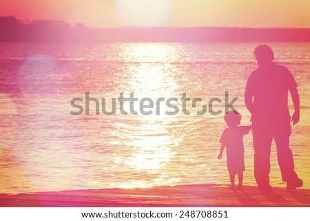 Father and son  on a dock at sunset. Instagram effect - stock photo