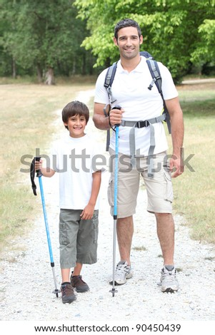 Father and son on a hike - stock photo