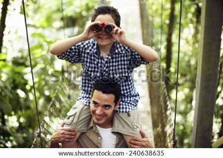 Father and Son on Bridge in Wilderness Area - stock photo
