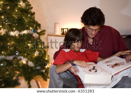 father and son on couch at christmas - stock photo