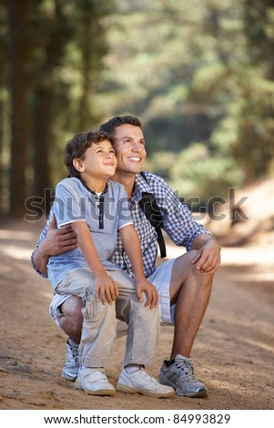 Father and son on country walk - stock photo