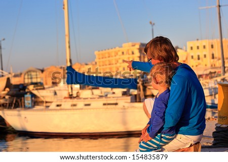 Father and son on Greece vacation - stock photo
