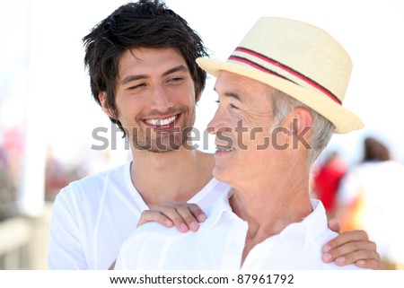 Father and son on holiday - stock photo