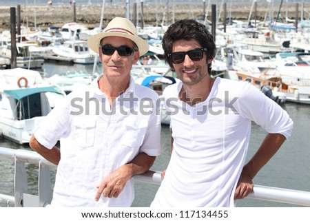 Father and son on holiday together - stock photo