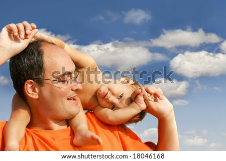 father and son on sky background - stock photo