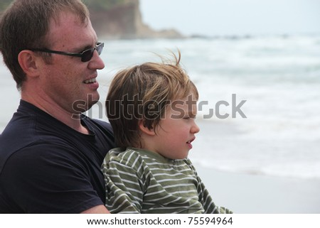 Father and son on the beach,  portrait - stock photo