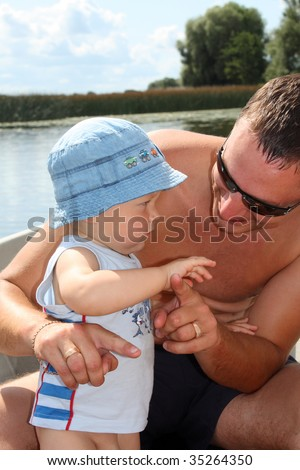 Father and son on the boat - stock photo