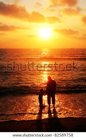 father and son on the sea - stock photo