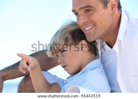 father and son on vacation - stock photo