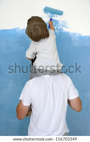 father and son paint room - stock photo
