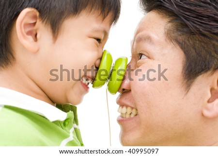 father and son playing - stock photo