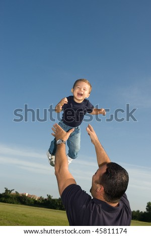 Father and Son Playing at the Park - stock photo