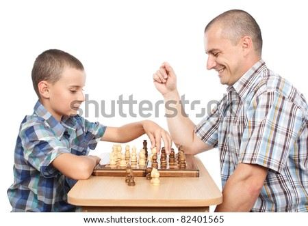 Father and son playing chess, isolated on white background