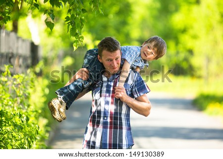Father and son playing in the park - stock photo