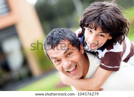 Father and son playing outdoors and having fun - stock photo
