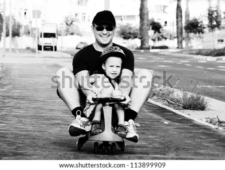 Father and son playing together - stock photo