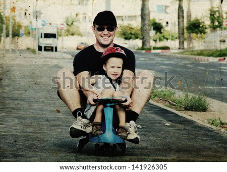Father and son playing together. Photo in old image style - stock photo